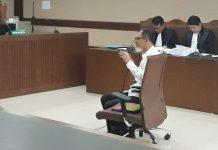 Mantan Kepala Biro Perencanaan dan Organisasi Bakamla, Nofel Hasan, duduk di kursi terdakwa di Pengadilan Tipikor Jakarta