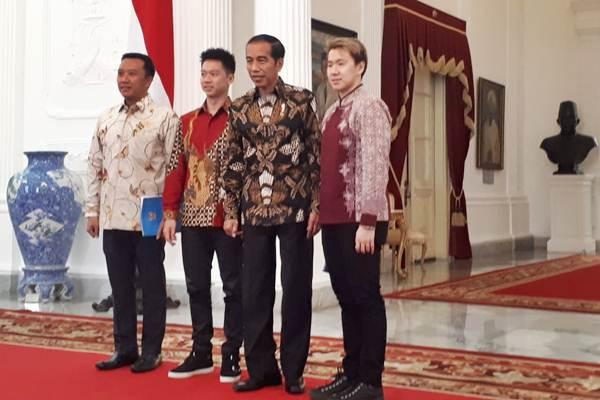 Kevin Sanjaya, Marcus Fernaldi Gideon saat bertemu Presiden Jokowidodo di Istana Merdeka