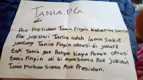 Tulisan Tania.