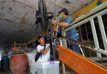Pasar Tradisional Surabaya Dipasang Kipas Angin Disinfektan.