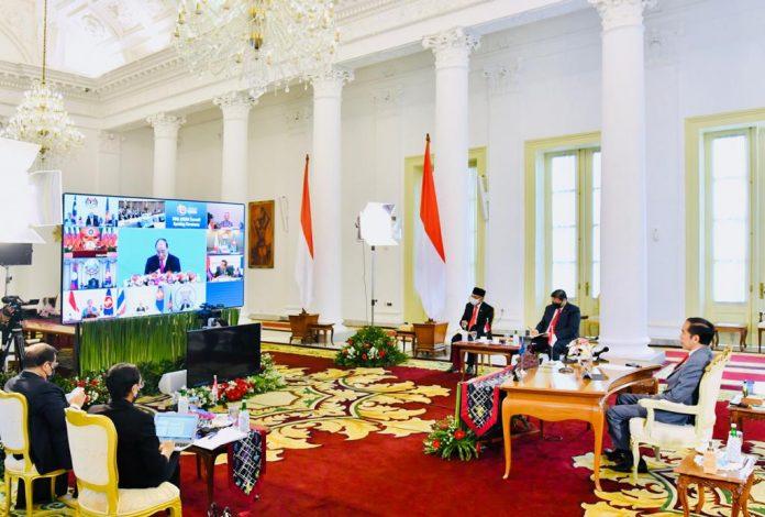 Presiden Joko Widodo (Jokowi) turut mengikuti upacara pembukaan Konferensi Tingkat Tinggi (KTT) ke-36 ASEAN melalui telekonferensi dari Istana Kepresidenan Bogor, Jawa Barat, Jumat, 26 Juni 2020.